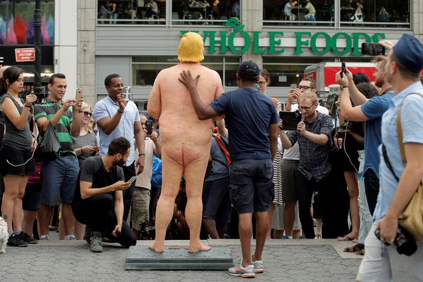 naked trump statue five